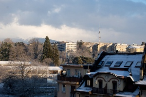 The sun casts shadow over snow-covered Geneva.