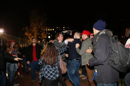 A Hillary Clinton supporter clashes with a Donald Trump supporter outside the White House (Getty Images)